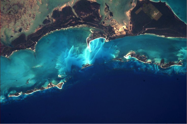 "Photo by Chris Hadfield, Astronaut who said in an interview: ""The most beautiful [view] to me are the Bahamas, the vast glowing reefs of every shade of blue that exists"". http://www.bbc.com/news/technology-21497468"